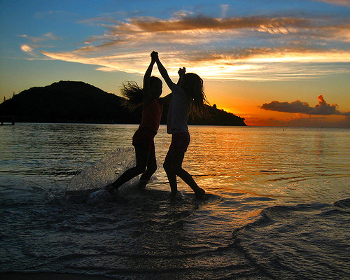 Girls-Playing-in-Water-Sunset